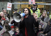 Russell Brand with parents and children from the New Era Estate addresses a rally outside Westbrook Partners in Mayfair in protest at the corporate threat to their homes. - Stefano Cagnoni - 01-12-2014