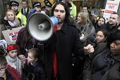 Russell Brand with parents and children from the New Era Estate addresses a rally outside Westbrook Partners in Mayfair in protest at the corporate threat to their homes. - Stefano Cagnoni - 2010s,2014,activist,activists,adult,adults,against,Brand,CAMPAIGN,campaigner,campaigners,CAMPAIGNING,CAMPAIGNS,child,CHILDHOOD,children,communities,community,demonstrate,DEMONSTRATING,demonstration,DE