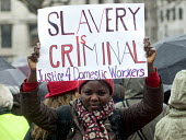 One Billion Rising For Justice: Domestic worker holding a placard that reads: Slavery Is Criminal, London rally, Trafalgar Square, part of the global day of protest against violence against women and... - Stefano Cagnoni - 2010s,2012,4,activist,activists,against,anti,BAME,BAMEs,black,BME,bmes,campaign,campaigner,campaigners,campaigning,CAMPAIGNS,Criminal,CRIMINALS,DEMONSTRATING,demonstration,DEMONSTRATIONS,Diaspora,dive