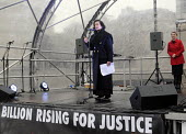 One Billion Rising For Justice: Bianca Jagger speaking, watched by Yvette Cooper MP. London rally, Trafalgar Square, part of the global day of protest against violence against women and girls. - Stefano Cagnoni - 2010s,2012,activist,activists,against,Bianca Jagger,campaign,campaigner,campaigners,CAMPAIGNING,CAMPAIGNS,cover,covered,DEMONSTRATING,demonstration,DEMONSTRATIONS,Diaspora,female,foreign,foreigner,for