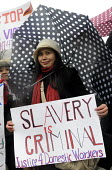 One Billion Rising For Justice Domestic worker holding a banner that reads Slavery Is Criminal London rally, Trafalgar Square, part of the global day of protest against violence against women and girl... - Stefano Cagnoni - 2010s,2012,4,activist,activists,against,anti,BAME,BAMEs,Black,BME,bmes,campaign,campaigner,campaigners,campaigning,CAMPAIGNS,Criminal,CRIMINALS,DEMONSTRATING,demonstration,DEMONSTRATIONS,Diaspora,dive