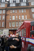 Highly emotional scenes at Clerkenwell Fire Station as the last shift comes off duty before the 141 year old station is closed permanently as part of the cuts to London fire service provision, instiga... - Stefano Cagnoni - 09-01-2014
