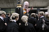 Save Legal Aid : wigged barristers towered over by a Chris Grayling puppet outside a blockaded Ministry of Justice, following their march their from Parliament. Grayling Day. Westminster. London. - Stefano Cagnoni - 07-03-2014