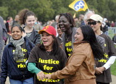 TUC Britain Needs A Pay Rise national demonstration and rally, 2014, London. Domestic workers having fun at the rally. - Stefano Cagnoni - 2010s,2014,activist,activists,against,Austerity Cuts,BAME,BAMEs,black,BME,bmes,Britain Needs A Pay Rise,CAMPAIGN,campaigner,campaigners,CAMPAIGNING,CAMPAIGNS,demonstrate,DEMONSTRATING,demonstration,DE
