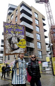 March For Homes. Demonstration for affordable housing, rent controls and building of new social housing in the UK. Passing by new build properties in south London. - Stefano Cagnoni - 31-01-2015