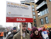 March For Homes. Demonstration for affordable housing, rent controls and building of new social housing in the UK. The protest passes by new build properties in south London. - Stefano Cagnoni - 31-01-2015