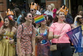 Pride in London Parade, 2015. Young women enjoy the passing parade. - Stefano Cagnoni - 27-06-2015