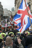 Anti-racist demonstrators confront Union Jack waving fascists at Piccadilly Circus, London. - Stefano Cagnoni - 21-03-2015