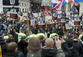 Fascists making the V for Victory sign goad anti-racist demonstrators on an anti-racism march, Piccadilly Circus, London. - Stefano Cagnoni - 21-03-2015