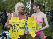 "Beach Body Ready protest. Male supporter joins women dressed in swimming costumes as they demonstrate in Hyde park against Protein World's ""sexist"" advertisement, criticised for promoting an unrealist... - Stefano Cagnoni - 02-05-2015"