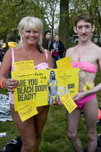 "Beach Body Ready protest. Women and men, in swimming costumes, demonstrate in Hyde park against Protein World's ""sexist"" advertisement, criticised for promoting an unrealistic image of women's bodies. - Stefano Cagnoni - 02-05-2015"