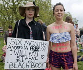 "Beach Body Ready protest. Women demonstrate in Hyde park against Protein World's ""sexist"" advertisement, criticised for promoting an unrealistic image of women's bodies. - Stefano Cagnoni - 2010s,2015,activist,activists,advertisement,against,anorexia,bare,Beach,BEACHES,bigotry,bodies,body,body shape,Body Weight,CAMPAIGN,campaigner,campaigners,CAMPAIGNING,CAMPAIGNS,COAST,coastal,coasts,de"