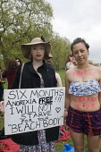 "Beach Body Ready protest. Women, demonstrate in Hyde park against Protein World's ""sexist"" advertisement, criticised for promoting an unrealistic image of women's bodies. - Stefano Cagnoni - 2010s,2015,activist,activists,advertisement,against,anorexia,bare,Beach,BEACHES,bigotry,bodies,body,body shape,Body Weight,CAMPAIGN,campaigner,campaigners,CAMPAIGNING,CAMPAIGNS,COAST,coastal,coasts,de"