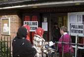 General Election, 2015. Muslim women arrive at polling station to cast their votes, Holloway, north London. - Stefano Cagnoni - 2010s,2015,BAME,BAMEs,Black,BME,bmes,campaign,campaigning,CAMPAIGNS,cities,citizen,citizens,city,democracy,diversity,Election,elections,electorate,enfranchised,ethnic,ethnicity,female,General Election