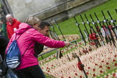 Couple look at the wooden crosses with poppies commemorating the dead of World War One, planted in the Royal Legion Field of Remembrance, Westminster, 2015. - Stefano Cagnoni - 04-11-2015