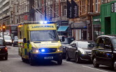 Ambulance on emergency call, central London, 2015. - Stefano Cagnoni - 2010s,2015,accident,accidental,accidents,ambulance,AMBULANCES,AUTO,AUTOMOBILE,AUTOMOBILES,AUTOMOTIVE,cab,cabs,Call,car,care,cars,cities,city,CONGESTED,congestion,DIA,driver,drivers,driving,emergency,E