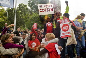 Supporters of Jeremy Corbyn's bid to become elected Leader of the Labour Party celebrate wildly outside the QEII Centre in Westminster as news of his victory in the membership ballot reaches them. - Stefano Cagnoni - 12-09-2015