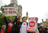 Supporters of Jeremy Corbyn's bid to become elected Leader of the Labour Party celebrate outside the QEII Centre in Westminster as news of his victory in the membership ballot reaches them. - Stefano Cagnoni - 12-09-2015