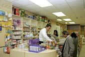 Pharmacy in south London - Stefano Cagnoni - 2000s,2002,asian,BAME,BAMEs,black,BME,BME Black minority ethnic,bmes,bought,buy,buyer,buyers,buying,chemist,chemists,cities,city,commodities,commodity,consumer,consumers,customer,CUSTOMERS,diversity,d