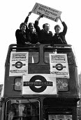 Ken Livingstone with Tony Banks, Andy Harris and Valerie Wise 1982 on the top deck of London bus promoting the GLC Fair Fares Campaign, London. The policy of low fares on public transport, opposed by... - Stefano Cagnoni - 1980s,1982,bus,bus service,BUSES,candidate,CANDIDATES,deck,Double Decker,Fair,Fares,GLC,Greater London Council,independent,Ken,Livingstone,local authority,London,MAYOR,Mayoral,MAYORS,POL politics,publ