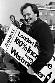GLC Leader Ken Livingstone on the top deck of a London bus promoting the Greater London Council's 'Fair Fares Campaign' in 1982 - Stefano Cagnoni - ,1980s,1982,bus,bus service,BUSES,candidate,CANDIDATES,deck,Fares,independent,Ken,Leader,Livingstone,London,MAYOR,Mayoral,MAYORS,POL politics,public,Red,service,services,transport,transportation,trans