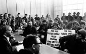 Arthur Scargill and Mick MacGahey listen to miners from South Wales lobbying an NUM Executive meeting in 1983 calling for a national strike ballot to protect their pits from closure - Stefano Cagnoni - 1980s,1983,activist,activists,Arthur Scargill,banner,BANNERS,CAMPAIGN,campaigner,campaigners,CAMPAIGNING,CAMPAIGNS,CLOSED,closing,closure,closures,DEMONSTRATING,DEMONSTRATION,DEMONSTRATIONS,DISPUTE,DI