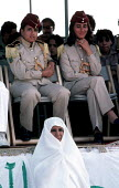 Female soldiers in the Libyan army look on at an older veiled Muslim woman - Stefano Cagnoni - 1980s,1984,african,Arab,Arabic,Arabs,armed forces,army,burkha,dress,FEMALE,hajib,headscarf,hijab,islam,islamic,Libyan,Libyans,military,monotheistic,MUSLEM,musli,Muslim,muslims,North Africans,people,pe