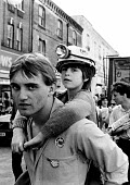 Striking miner with his son on his shoulders, Demonstration in support of the Miners strike, Greenwich, London 1984 - Stefano Cagnoni - 1980s,1984,boy boys,child children,DAD,DADDIES,DADDY,DADS,DEMONSTRATING,Demonstration,disputes,families,family,father,FATHERHOOD,fathers,INDUSTRIAL DISPUTE,London,male,MAN,man men,member,member member