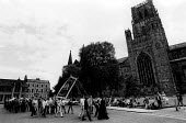 Durham Miners Gala miners with their lodge banner make their way into Durham Cathedral for the very last time as their pit had closed earlier that year. - Stefano Cagnoni - 1980s,1984,activist,activists,CAMPAIGN,campaigner,campaigners,CAMPAIGNING,CAMPAIGNS,carries,carry,carrying,Cathedral,CATHEDRALS,clergy,closed,closing,closure,closures,County Durham,DEMONSTRATING,demon