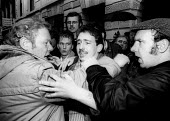 Ray Chadburn, on left, from Notts NUM consoles a young miner in tears as he and the rest of the miners, lobbying a special meeting of the NUM Executive, learn that the year long strike is to be called... - Stefano Cagnoni - 03-03-1985