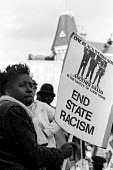 Young woman on Justice for Black People demonstration in 1985 - called following the deaths of two innocent black women, Cherry Groce and Cynthia Jarrett - Stefano Cagnoni - 1980s,1985,activist,activists,BAME,BAMEs,banner,BANNERS,bigotry,Black,BME,bmes,CAMPAIGN,campaigner,campaigners,CAMPAIGNING,CAMPAIGNS,DEATH,deaths,demonstrate,DEMONSTRATING,demonstration,DEMONSTRATIONS