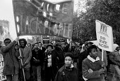 Justice for Black People demonstration in 1985 - called following the deaths of two innocent black women, Cherry Groce and Cynthia Jarrett. Paul Boateng can be seen behind the leading marchers - Stefano Cagnoni - 1980s,1985,activist,activists,BAME,BAMEs,banner,banners,bigotry,Black,BME,bmes,CAMPAIGN,campaigner,campaigners,CAMPAIGNING,CAMPAIGNS,DEATH,deaths,demonstrate,DEMONSTRATING,demonstration,DEMONSTRATIONS