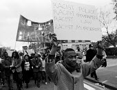 Young man at the head of a Justice for Black People demonstration in 1985 - called following the deaths of two innocent black women, Cherry Groce and Cynthia Jarrett - Stefano Cagnoni - 1980s,1985,activist,activists,BAME,BAMEs,banner,banners,bigotry,Black,BME,bmes,CAMPAIGN,campaigner,campaigners,CAMPAIGNING,CAMPAIGNS,DEATH,deaths,demonstrate,DEMONSTRATING,demonstration,DEMONSTRATIONS