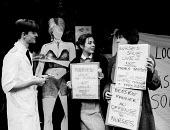 Nurses protest at Bedside Manner restaurant, London, 1985 against its policy of dressing waitresses in sexy nurse uniforms in order to attract male customers - Stefano Cagnoni - 20-12-1985