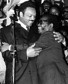 Jesse Jackson embraces ANC President, Oliver Tambo in Trafalgar Sqaure at an Anti-Apartheid rally held in London - Stefano Cagnoni - 15-07-1985