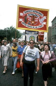 Women marching through Durham at The MIners Gala in 1986 - Stefano Cagnoni - 1980s,1986,banner,BANNERS,barnsley,Big,communities,community,County Durham,DEMONSTRATING,demonstration,Durham,female,Gala,labour,march,marching,Meeting,MEETINGS,member,member members,members,MINER,MIn