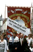 Marching through Durham at The MIners Gala in 1986 - Stefano Cagnoni - 1980s,1986,banner,BANNERS,County Durham,DEMONSTRATING,demonstration,disputes,Durham MIners Gala,female,INDUSTRIAL DISPUTE,Kinsley,march,Marching,member,member members,members,message,miner,miners,MINE