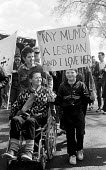 Dan Gillespie holding a placard My Mum is a Lesbian and I love her- Positive Images protest marching through Haringey, 1987. He is now a musician, singer, songwriter and guitarist in the pop rock grou... - Stefano Cagnoni - 22-09-1987