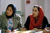 Local Asian women attending classes in English at the St Barnabas Church & Community Centre in Blackburn - Stefano Cagnoni - 1990s,1995,additional,adult,Adult Education,ADULTS,Asian,attention,attentive,BAME,BAMEs,bilingual,black,blackboard,BLACKBOARDS,BME,bmes,class,communicating,communication,diversity,EAL,EDU education,ed