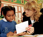 Headteacher working with pupil in classroom of south London primary school - Stefano Cagnoni - ,1990s,1997,attentive,BAME,BAMEs,black,BME,bmes,bright,child,CHILDHOOD,children,cities,city,class,classroom,CLASSROOMS,communicating,communication,diversity,EDU education,educating,employee,employees,