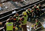 An emergency rescue service team at the site of the Paddington rail crash take a rest before continuing their search of the wrecked train carriages. The accident resulted in the death of dozens of com... - Stefano Cagnoni - 06-10-1999
