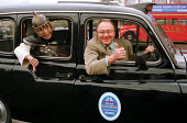 Ken Livingstone gets the 'thumbs down' from a 'Roman centurion' as he sits at the driving wheel of a London taxi cab - part of a promotion for London tourist guides - Stefano Cagnoni - 1990s,1999,BAME,BAMEs,Black,blackcab,BME,bmes,cab,CABS,cas,diversity,DRIVER,DRIVERS,driving,ethnic,ethnicity,highway,holiday,holiday maker,holiday makers,holidaymaker,holidaymakers,holidays,Labour Par