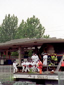Specially trained police officers, dressed in protective clothing, remove the body of a victim of the train crash on a stretcher. Potters Bar rail crash. - Stefano Cagnoni - 2000s,2002,accident,accidental,ACCIDENTS,adult,adults,apparel,bar,BARS,bodies,body,carriage,CARRIAGES,cities,city,CLJ,clothing,crash,death,DEATHS,derailment,DIA disasters & accidents,died,Emergency Se