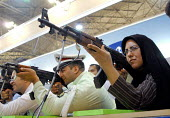 An Iranian woman shoots at a target with a laser gun, during a police exhabition in Tehran ,Iran. - Siavash Habibollahi - 25-06-2008