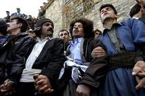 A group of kurdish men dancing and singing with Daf during a marriage ceremony of Pir-e-Shahyar in Uraman Takht village. Uramanat, South Eastern Marivan, Iran - Siavash Habibollahi - 03-02-2005