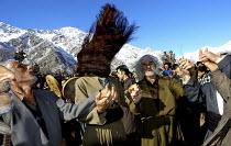 A circle of kurdish men - dervishes - dancing and singing with Daf during a marriage ceremony of Pir-e-Shahyar in Uraman Takht village. Uramanat, South Eastern Marivan, Iran - Siavash Habibollahi - 03-02-2005