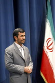Iranian president Mahmoud Ahmadinejad stands near of Iran's flag during the 14th international and fair of press and news agencies in Tehran, Iran. - Siavash Habibollahi - 13-11-2007