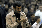 Iran's President Mahmoud Ahmadinejad prays during a religious ceremony to mark the anniversary of the death of the first Shi'ite Muslim, Imam al-Ali, at a grand mosque in Tehran, Iran. - Siavash Habibollahi - 19-06-2008