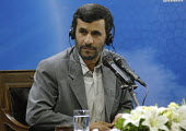 Iran's President Mahmoud Ahmadinejad listens with earphones during a news conference in Tehran, Iran. - Siavash Habibollahi - 13-05-2008