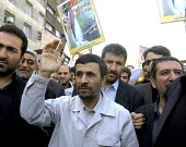 Iran's President Mahmoud Ahmadinejad greets supporters as he attends in an anti-Israeli rally marking Al-Quds Day (Jerusalem Day), to support the Palestinian cause, in Tehran, Iran. Millions of Irani... - Siavash Habibollahi - 05-10-2007